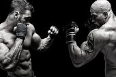 Two fighters fighting in front of black background