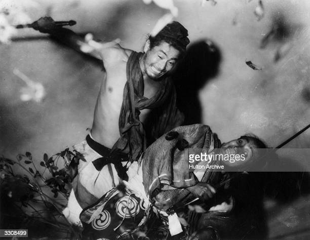 A fight scene from the Japanese film 'Rashomon' translated as 'In The Woods' and adapted from the writings of Ryunosuke Akutagawa The film was...
