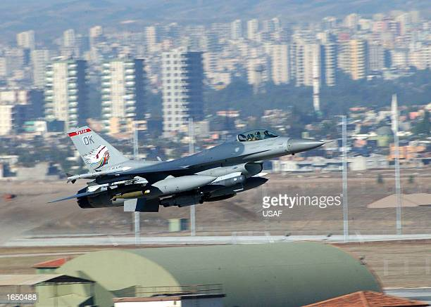 S F16CG fighter aircraft takes off from Incirlik Air Base November 17 2002 in Adana Turkey The plane is assigned to Combined Task Force in support of...