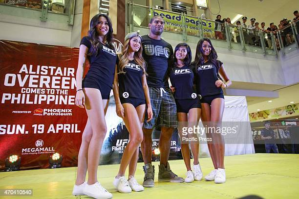UFC fighter Alistair Overeem poses with the finalists of the search for the first Asian Octagon Girl at the SM Megamall event center on Sunday April...