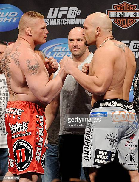 UFC fighter Brock Lesnar faces off at weighins against UFC fighter Shane Carwin for their Heavyweight Championship fight at UFC 116 on July 2 2010 in...