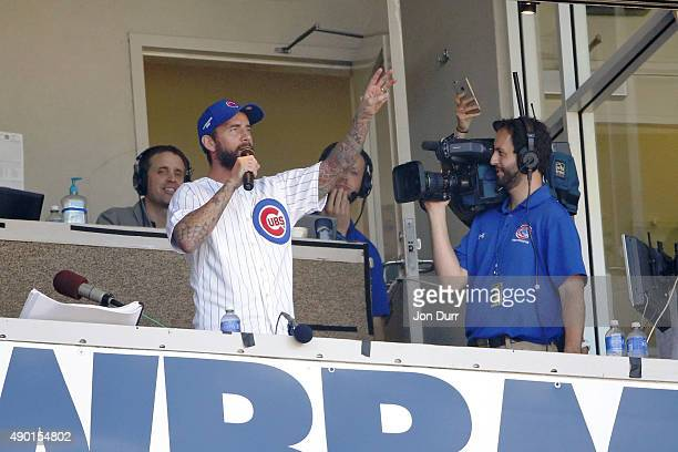 UFC fighter CM Punk sings the seventh inning stretch during the game between the Chicago Cubs and the Pittsburgh Pirates at Wrigley Field on...