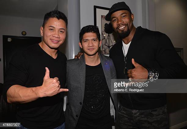 MMA fighter Cung Le actor Iko Uwais and actor Michael Jai White attend the after party for the premiere of Sony Pictures Classics' 'The Raid 2' at...
