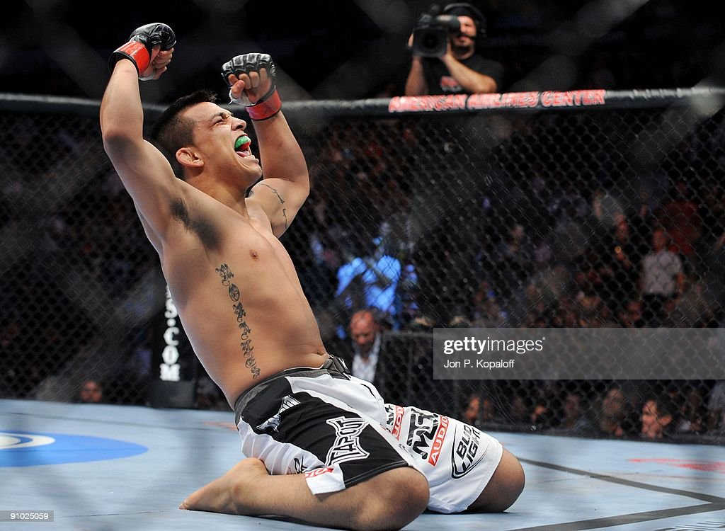 UFC fighter Efrain Escudero celebrates after knocking out UFC fighter Cole Miller during their Lightweight bout at UFC 103 Franklin vs Belfort at the...