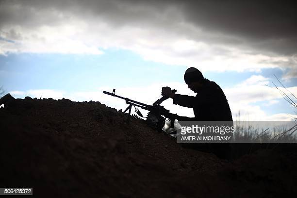 A fighter from Jaish alIslam the foremost rebel group in Damascus province who fiercely oppose to both the regime and the Islamic State group loads...