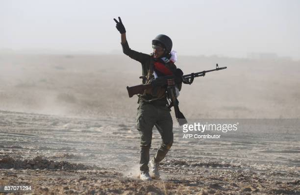 A fighter from the Hashed AlShaabi gestures as they advance towards the town of Tal Afar west of Mosul after the Iraqi government announced the...