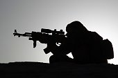 A fighter from the Iraqi Imam Ali Brigade take part in a training exercise in Iraq's central city of Najaf on March 7 ahead of joining the military...