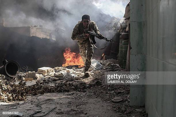 A fighter from the Jaish alIslam runs to avoid sniper fire in the village of Tal alSiwan area of the rebelheld stronghold of Douma on the outskirts...
