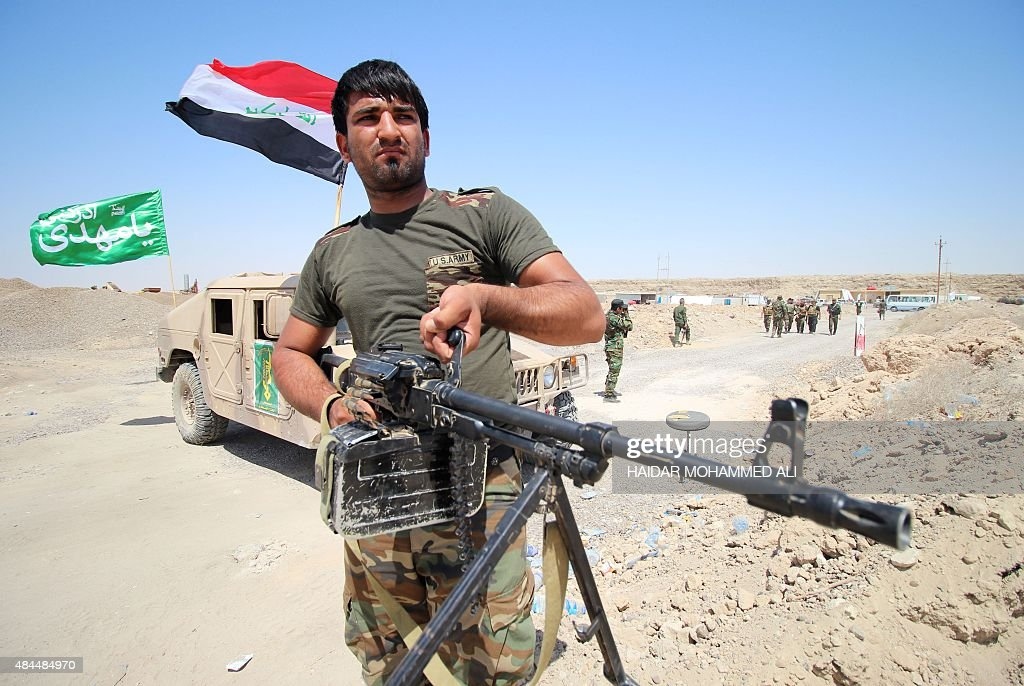 A fighter from the Popular Mobilisation units holds a weapon on the front line during a military operation against Islamic State group jihadists on...