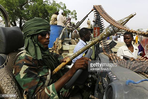 A fighter from the Sudanese Rapid Support Forces sits in an armed vehicle in the city of Nyala in south Darfur on May 3 as they display weapons and...