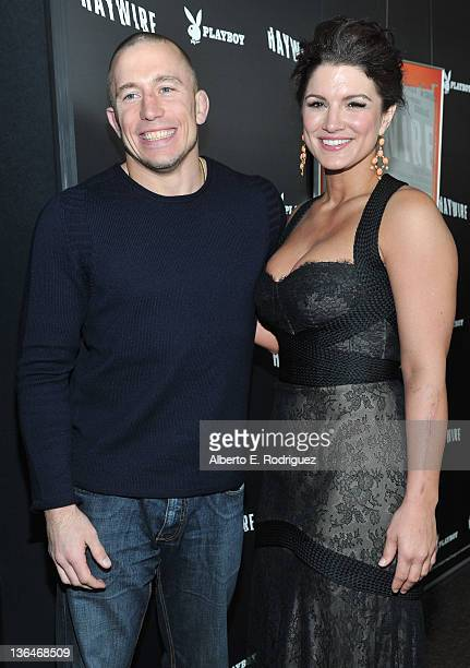 UFC fighter Georges StPierre and actress Gina Carano arrive to the premiere of Relativity Media's 'Haywire' at DGA Theater on January 5 2012 in Los...