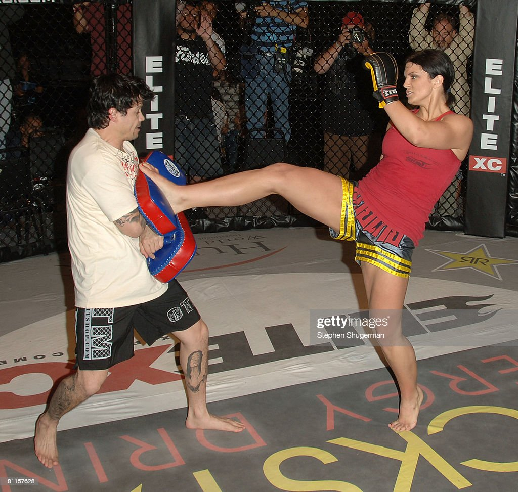 MMA fighter Gina Carano (R) demonstrates MMA fighter techniques at CBS's 'Elite XC Saturday Night Fights' Press Conference at CBS Radford Studios on May 19, 2008 in Studio City, California.