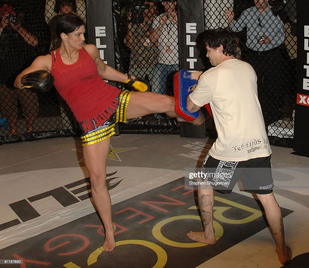 MMA fighter Gina Carano (L) demonstrates MMA fighter techniques at CBS's 'Elite XC Saturday Night Fights' Press Conference at CBS Radford Studios on May 19, 2008 in Studio City, California.