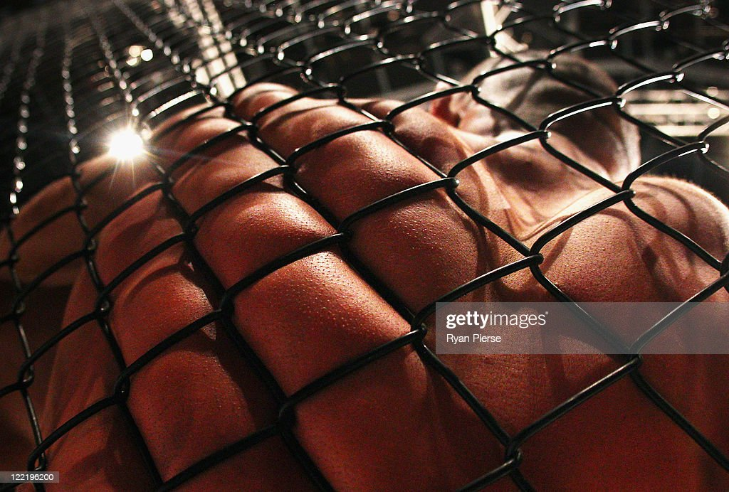 A fighter is pinned against the cage during CFC 18 at Luna Park on August 26 2011 in Sydney Australia
