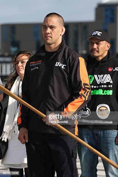 UFC fighter James Te Huna accepts the taiaha during a traditional maori welcome at Te Wero Bridge on June 24 2014 in Auckland New Zealand Fighters...