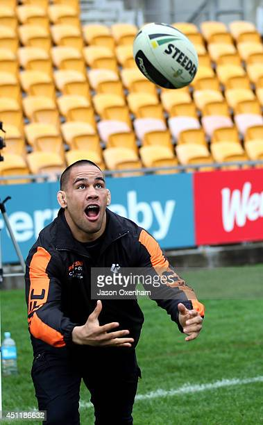 Fighter James Te Huna demonstrates his ball skills during a New Zealand Warriors NRL training session at Mt Smart Stadium on June 25 2014 in Auckland...