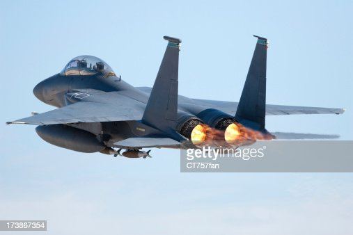 Fighter jet in flight with afterburners activated