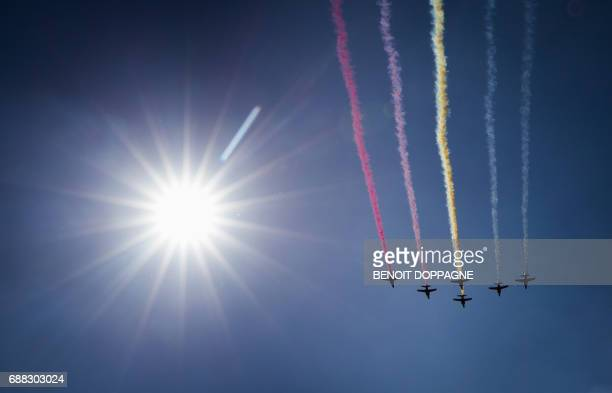 Fighter jets leave trails in the colours of the Belgian flag during the NATO summit ceremony at the NATO headquarters in Brussels on May 25 2017 /...