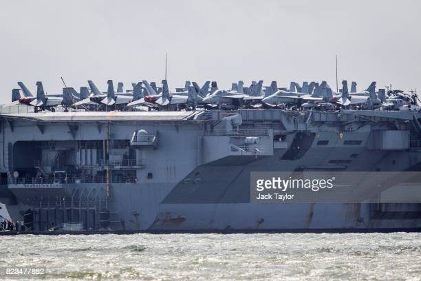 Fighter jets on the US Navy Nimitzclass aircraft carrier USS George HW Bush anchored off the coast on July 27 2017 in Portsmouth England The 100000...