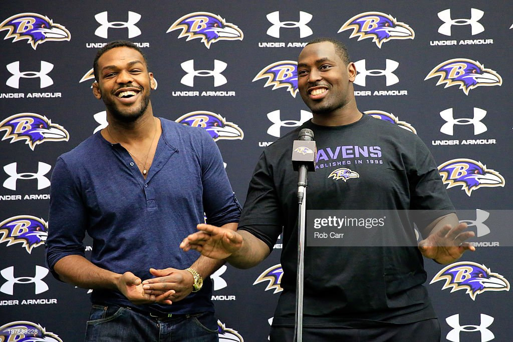 UFC fighter Jon Jones (L) jokes around with his brother defensive end Arthur Jones #97 of the Baltimore Ravens during a news conference at the teams training facility November 13, 2013 in Owings Mills, Maryland.