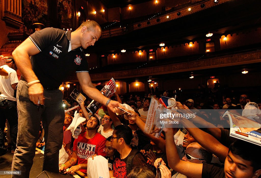 UFC fighter <a gi-track='captionPersonalityLinkClicked' href=/galleries/search?phrase=Junior+Dos+Santos&family=editorial&specificpeople=6312675 ng-click='$event.stopPropagation()'>Junior Dos Santos</a> interacts with the fans during a press conference at Beacon Theatre on July 31, 2013 in New York City.