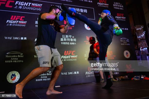 MMA fighter Kelvin Gastelum of the US fights with a trainer during an open workout session prior to UFC Fight Night in Shanghai on November 23 2017 /...