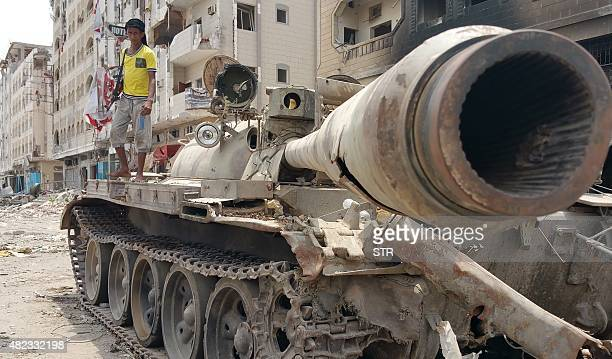 A fighter loyal to Yemen's exiled President Abedrabbo Mansour Hadi stands on a tank in Yemen's second city of Aden on July 30 2015 Rebel forces in...