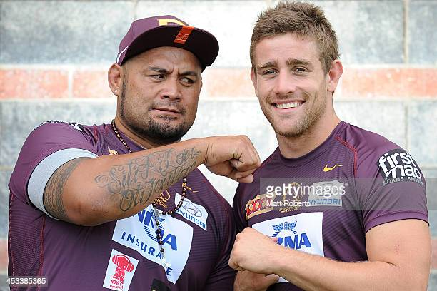 UFC fighter Mark Hunt and Andrew McCullough of the Broncos pose for a photograph during a UFC photocall on December 4 2013 in Brisbane Australia