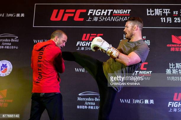MMA fighter Michael Bisping of England fights with a trainer during an open workout session prior to UFC Fight Night in Shanghai on November 23 2017...