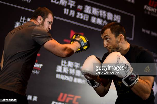 MMA fighter Muslim Salikhov of Dagestan fights with a trainer during an open workout session prior to UFC Fight Night in Shanghai on November 23 2017...