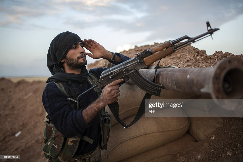 A fighter of the Kurdish of the Committees for the Protection of the Kurdish People holds a position in a trench on October 19 2013 in the Kurdish...