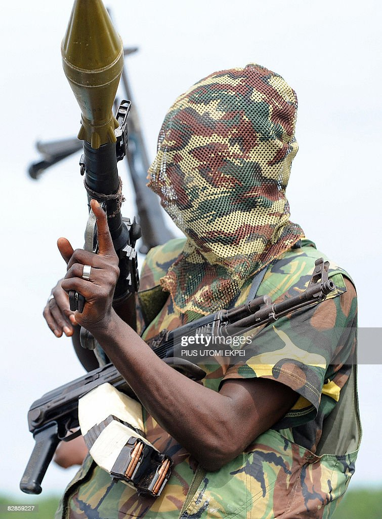 A fighter of the Movement for the Emancipation of the Niger Delta (MEND), holds his weapons at the militia's creek camp in the Niger Delta on September 17, 2008. Armed Nigerian militants who have declared an 'oil war' on September 14, in response to what it said was an unprovoked attack by the army, claimed to have blown up a major pipeline in their latest attack on oil installations in the region. MEND, the most prominent of the groups operating in the creeks and swamps of the Niger Delta, said it blew up a pipeline it believes is operated by Royal Dutch Shell and Italy's Agip. The rebels moved in with speed boats, dynamite and hand grenades in their attack on the Orubiri flow station, the army said. MEND says it is fighting for local people to get a greater share of the huge oil revenues. Since MEND took up arms in early 2006, Nigeria's oil output has been cut by at least one quarter due to kidnappings and sabotage in the Delta. Hurricane Barbarossa is the code name MEND has given to its new offensive against foreign majors.