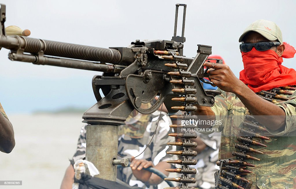 A fighter of the Movement for the Emancipation of the Niger Delta (MEND), poses with a heavy machine-gun at the militia's creek camp in the Niger Delta on September 17, 2008. Armed Nigerian militants who have declared an 'oil war' on September 14, in response to what it said was an unprovoked attack by the army, claimed to have blown up a major pipeline in their latest attack on oil installations in the region. MEND, the most prominent of the groups operating in the creeks and swamps of the Niger Delta, said it blew up a pipeline it believes is operated by Royal Dutch Shell and Italy's Agip. The rebels moved in with speed boats, dynamite and hand grenades in their attack on the Orubiri flow station, the army said. MEND says it is fighting for local people to get a greater share of the huge oil revenues. Since MEND took up arms in early 2006, Nigeria's oil output has been cut by at least one quarter due to kidnappings and sabotage in the Delta. Hurricane Barbarossa is the code name MEND has given to its new offensive against foreign majors. 'I derive satisfaction in destruction of oil installations in the Niger Delta', said Boy Loaf, leader of the militants.