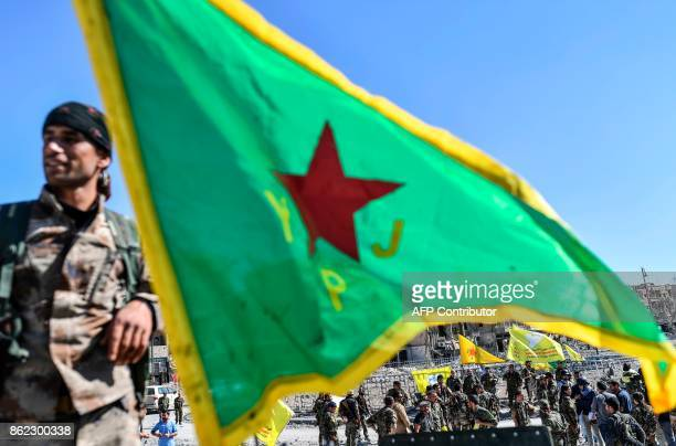 TOPSHOT A fighter of the Syrian Kurdish People's Protection Units a member group under the umbrella of the Syrian Democratic Forces backed by US...