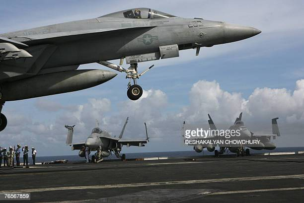 A US fighter plane prepares to touch down on US supercarrier Kitty Hawk in the Bay of Bengal during the Malabar exercise 07 September 2007...