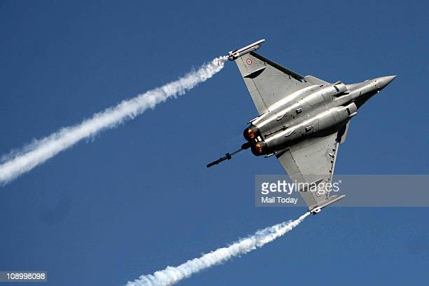 Fighter plane taking part in the Air Show as part of Aero India 2011 in Banglore on thursday