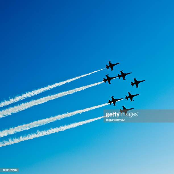 Fighter planes in airshow on blue sky