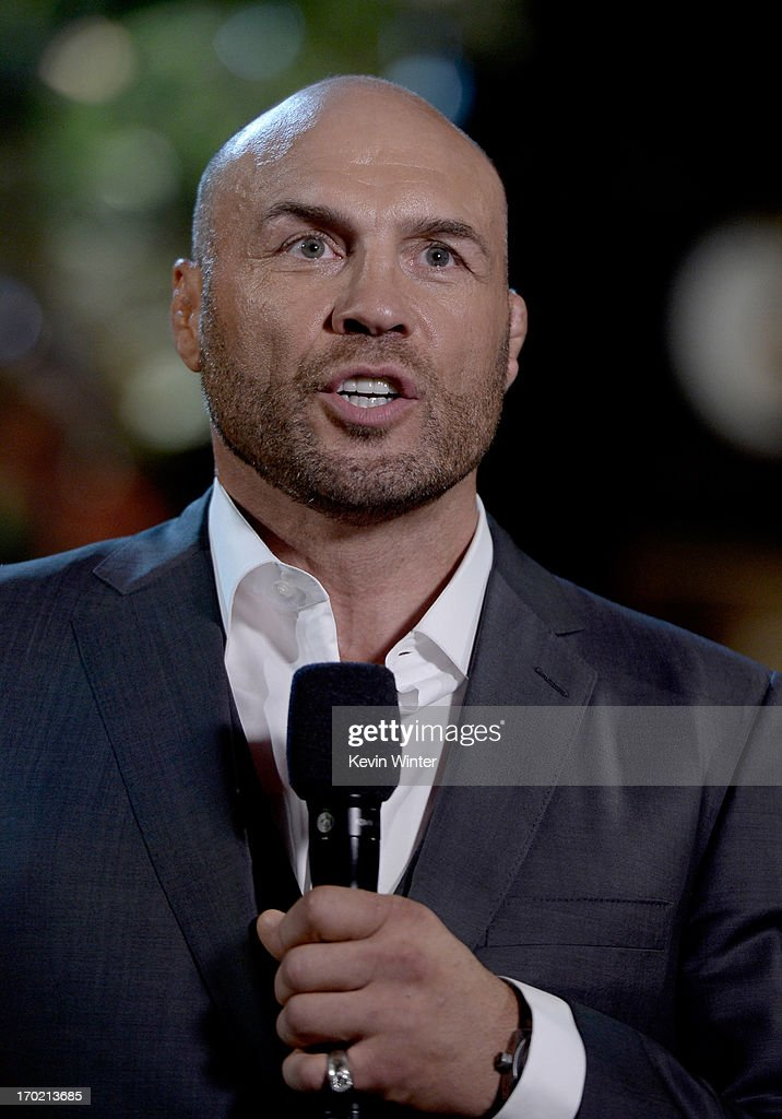 MMA fighter <a gi-track='captionPersonalityLinkClicked' href=/galleries/search?phrase=Randy+Couture&family=editorial&specificpeople=881313 ng-click='$event.stopPropagation()'>Randy Couture</a> speaks onstage during Spike TV's Guys Choice 2013 at Sony Pictures Studios on June 8, 2013 in Culver City, California.