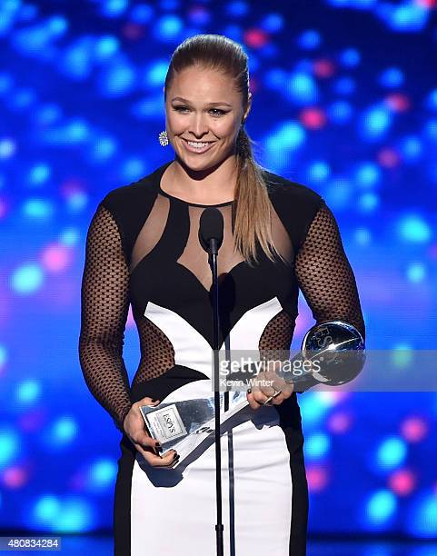 UFC fighter Ronda Rousey accepts the Best Female Athlete award onstage during The 2015 ESPYS at Microsoft Theater on July 15 2015 in Los Angeles...
