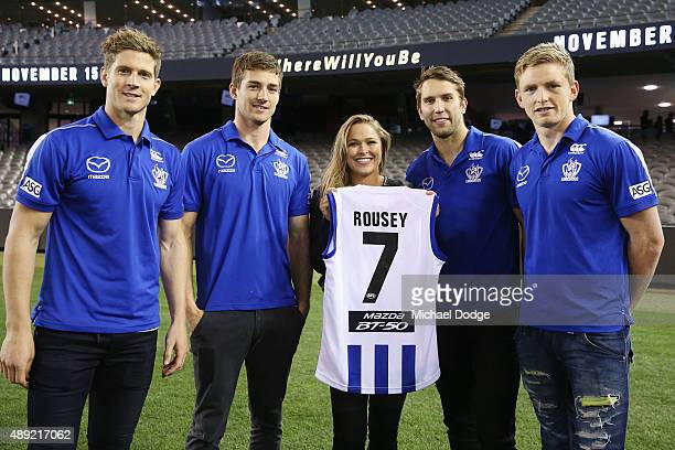 UFC fighter Ronda Rousey poses with Nick Dal Santo Shaun Atley Jamie Macmillan and Jack Ziebell of the Kangaroos AFL team on September 16 at Etihad...