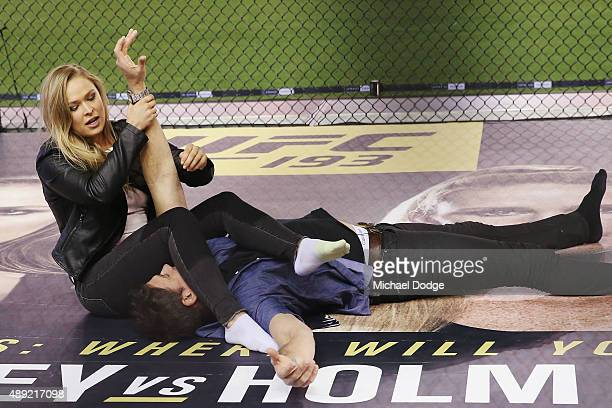 UFC fighter Ronda Rousey shows Matthew Richardson of Channel Seven some UFC holds before he introduces her to the Kangaroos AFL players on September...