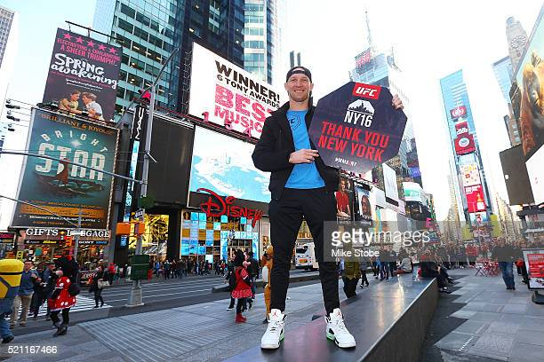 Fighter Ryan LaFlare visits Time Square prior to a bill signing to legalize Mixed Martial Arts fighting in the state on April 13 2016 in New York...