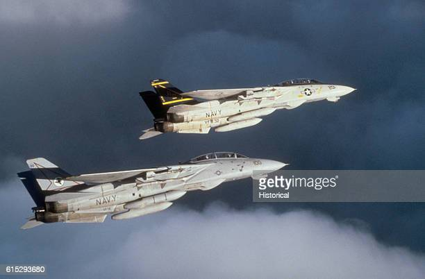 A Fighter Squadron 32 F14A Tomcat aircraft and a Fighter Squadron 14 F14A Tomcat aircraft on patrol during exercise Deterrent Force 2/90 a part of...