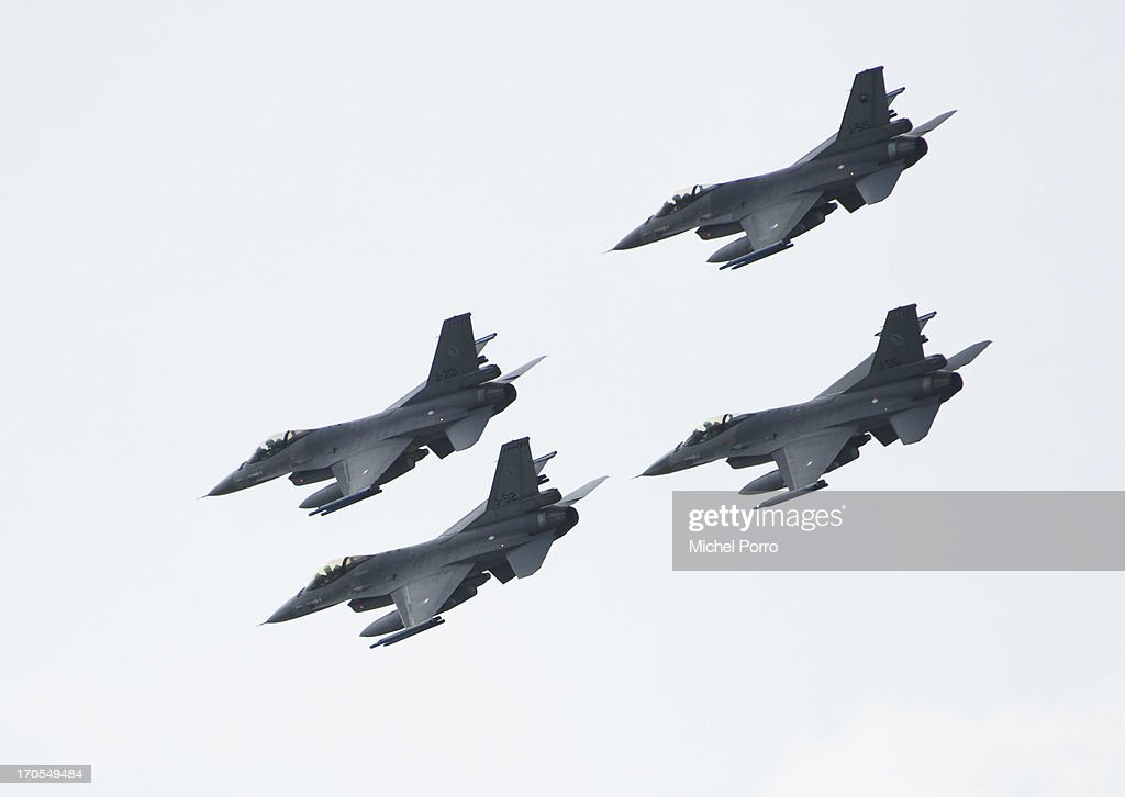 F16 fighter squadron fly by as King WillemAlexander and Queen Maxima of The Netherlands watch the army demonstration during the boat trip from...