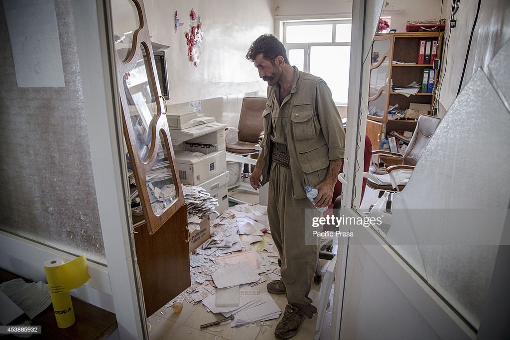 A PKK fighter stands in one of the hospital rooms that was recently ransacked by ISIS forces during the battle in Makhmour. Makhmour is a town located 50 kilometers South of Erbil, the Kurdistan Capital Regional Government once taken by ISIS but redeemed back by the help of PKK Fighters. Turkish PKK fighters were called for help by the Peshmergas to figth with the ISIS, as they are very seasoned on guerilla-style fight.