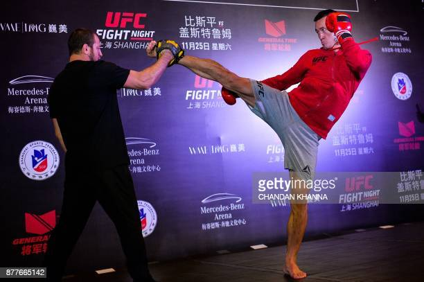 MMA fighter Wang Guan of China fights with a trainer during an open workout session prior to UFC Fight Night in Shanghai on November 23 2017 / AFP...