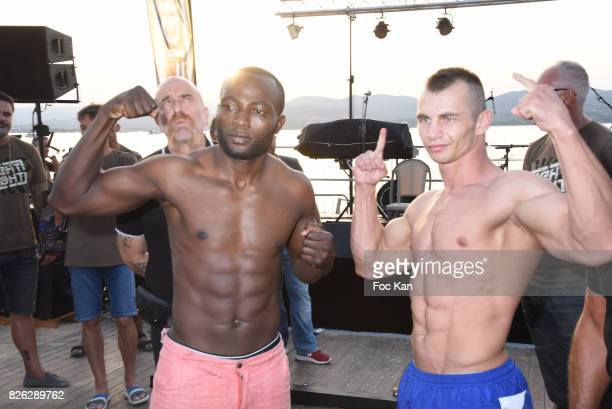 Fighters Evgeny Kuravskoi from Russia and Umar Ssematafrom Ouganda attend the Fight Night Weighing Party at La Bouillabaisse Saint Tropez on August 3...