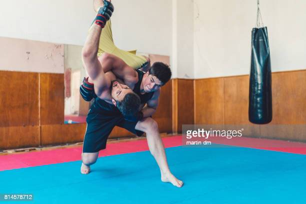 MMA Fighters fighting in the gym