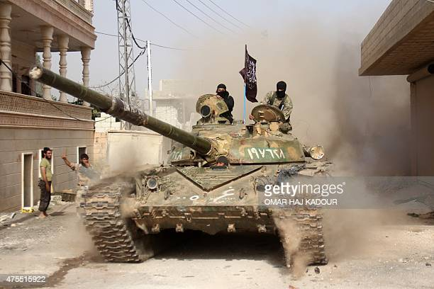 Fighters from a coalition of Islamist forces arrive to the town of Ariha on May 28 2015 in the Syrian city of Idlib the second provincial capital to...
