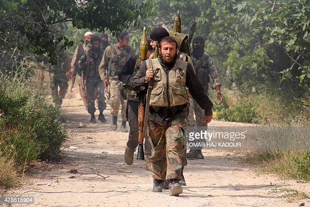 Fighters from a coalition of Islamist forces make their way on May 19 2015 to the AlMastumah base in the Syrian city of Idlib the second provincial...